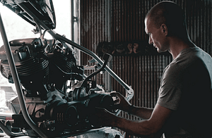 mechanic with engine