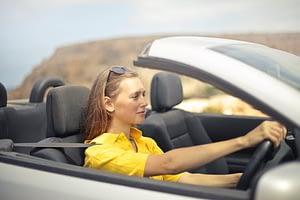 A lady speeding her car